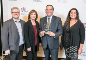 Pictured at the NCSHA Awards Ceremony: Scott Michael Dunn – of Costello Compliance, Kathleen Millerick, Michael DiChiaro and Lenore Coughlin – of RI Housing receiving NCSHA Award in Boston MA on October 21, 2019